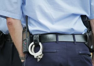 Police officer with handcuffs and radio