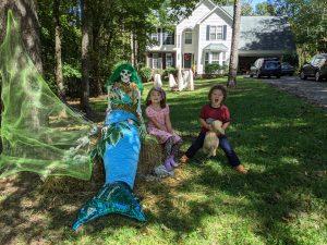 children with mermaid scarecrow