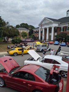 Cars stretched around the circle in front of the library.