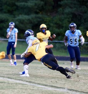Indy's Moshay Saw brings down a Hopewell runner. (Photo by Ron Morris)