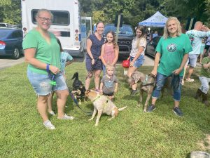 Melanie with Julia (adoptable), Jessica with Bucky (alumni), and Danielle Spueler and Tyson (adoptable) are with South Charlotte Dog Rescue and attended the Open House to attract more adopters!
