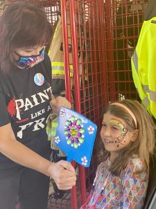 Bella Brush Face Painting shows Addison Kelly, 8, her completed look. Kelly's family came out to enjoy the community event from Charlotte. Her mom explained that friends in Waxhaw invited them to the Open House.