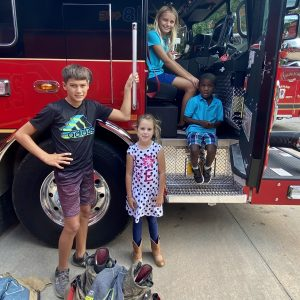 Graham (12), Grace (10), Lila (7), and Landon (4) get up close and personal with the Fire Trucks at the Waxhaw FD Open House. They just moved to Waxhaw and came to meet the town and their heros.