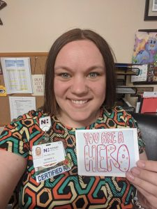 Nurse Bonnie Koski holds up a thank you card she received for being a health care hero during the COVID-19 pandemic.